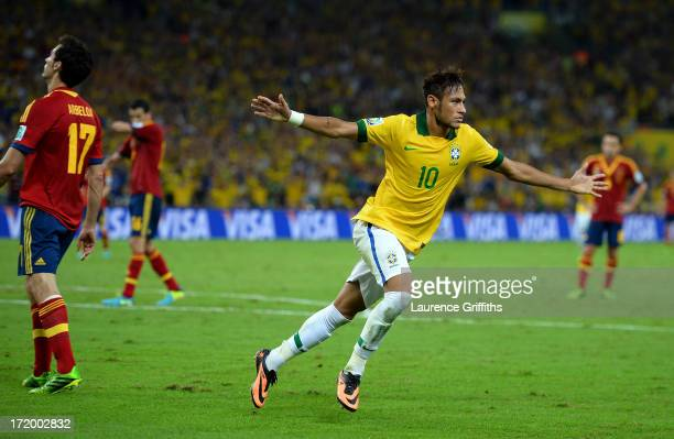 Neymar of Brazil celebrates scoring his team's second goal to make the score 2-0 during the FIFA Confederations Cup Brazil 2013 Final match between...