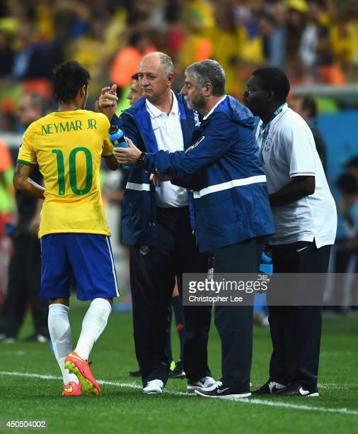 Neymar of Brazil celebrates scoring in the first half with head coach Luiz Felipe Scolari of Brazil during the 2014 FIFA World Cup Brazil Group A...