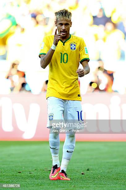 Neymar of Brazil celebrates scoring in the penalty shootout during the 2014 FIFA World Cup Brazil Round of 16 match between Brazil and Chile at...