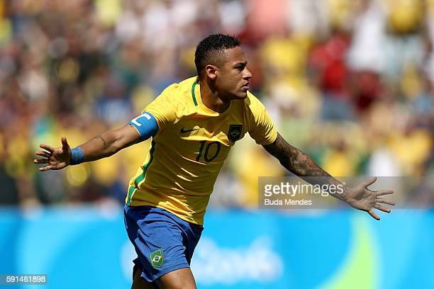 Neymar of Brazil celebrates scoring the first Brazil goal during the Men's Semifinal Football match between Brazil and Honduras at Maracana Stadium...