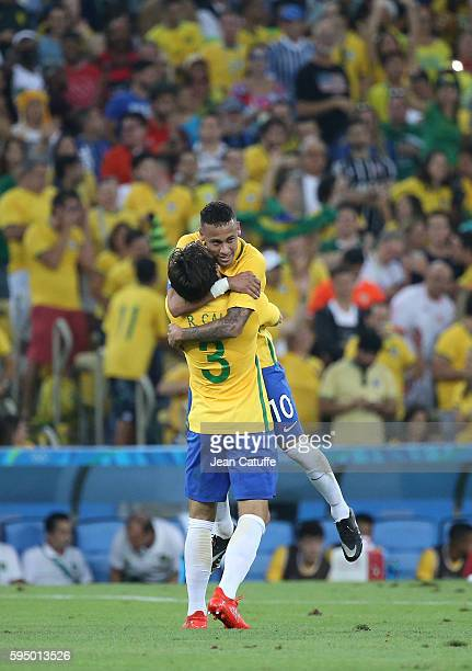Neymar of Brazil celebrates scoring the first goal with Rodrigo Caio during the Men's Soccer Final between Brazil and Germany on day 15 of the Rio...