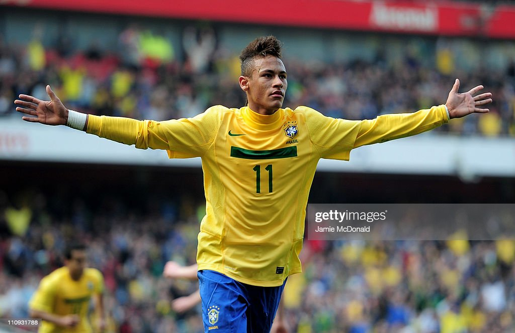 Neymar of Brazil celebrates scoring the opening goal during the International friendly match between Brazil and Scotland at Emirates Stadium on March 27, 2011 in London, England.