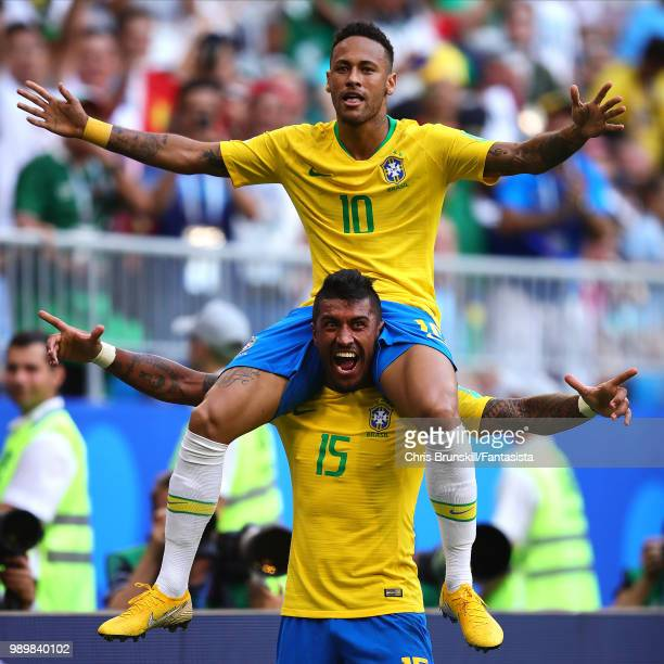 Neymar of Brazil celebrates scoring the opening goal with teammate Paulinho during the 2018 FIFA World Cup Russia Round of 16 match between 1st Group...