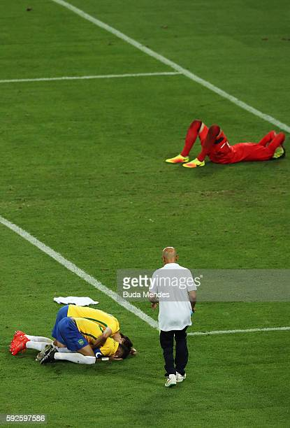 Neymar of Brazil celebrates scoring the winning penalty in the penalty shoot out as German keeper Timo Horn of Germany lays despondent during the...