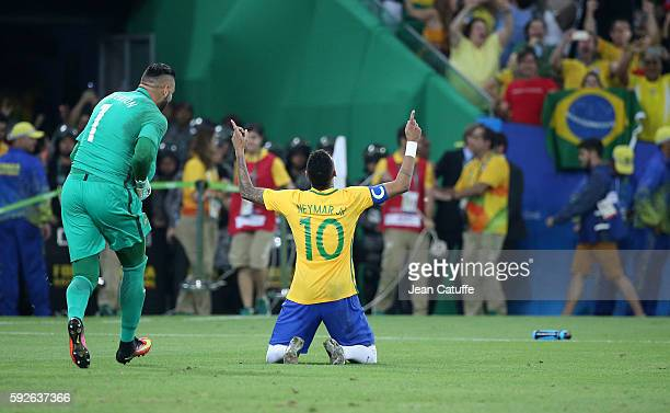 Neymar of Brazil celebrates to score his penalty to win the gold medal following the Men's Soccer Final between Brazil and Germany on day 15 of the...