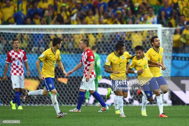 Neymar of Brazil celebrates with Dani Alves and Fred after a goal in the first half during the 2014 FIFA World Cup Brazil Group A match between...