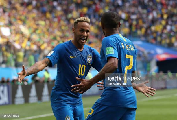 Neymar of Brazil celebrates with Douglas Costa of Brazil after scoring his team's second goal during the 2018 FIFA World Cup Russia group E match...
