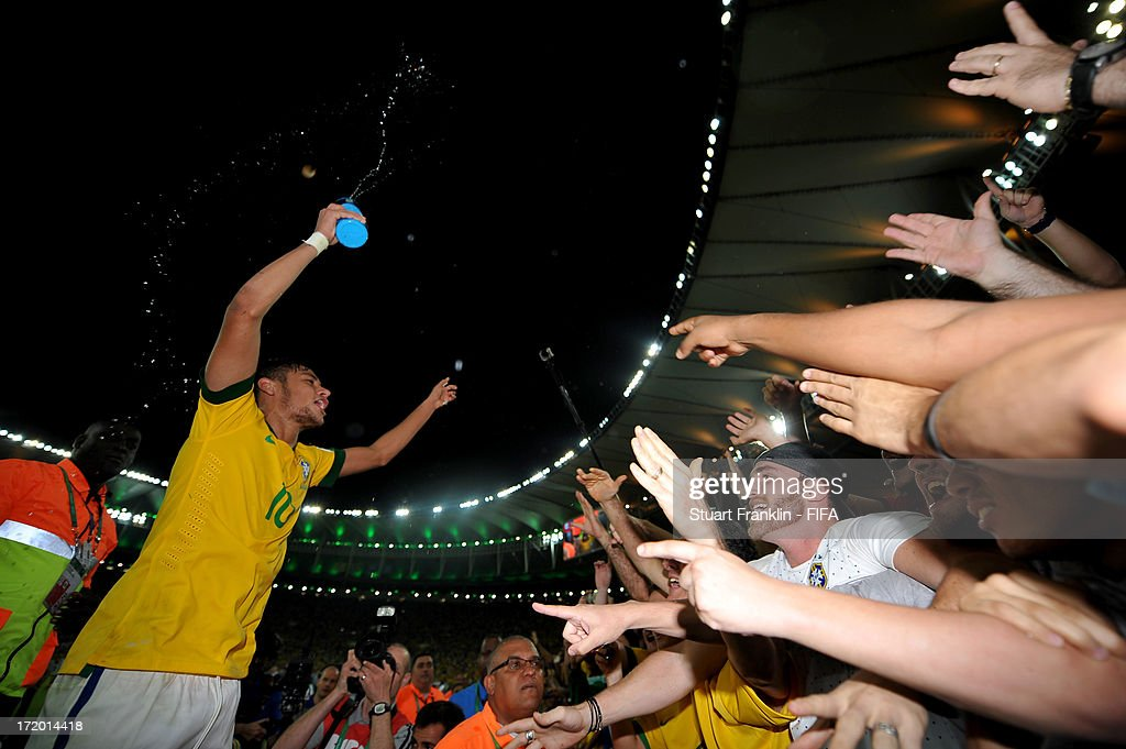 Neymar of Brazil celebrates with fans at the end of the FIFA Confederations Cup Brazil 2013 Final match between Brazil and Spain at Maracana on June 30, 2013 in Rio de Janeiro, Brazil.