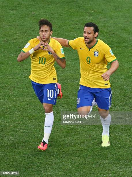 Neymar of Brazil celebrates with Fred after scoring a goal in the first half during the 2014 FIFA World Cup Brazil Group A match between Brazil and...