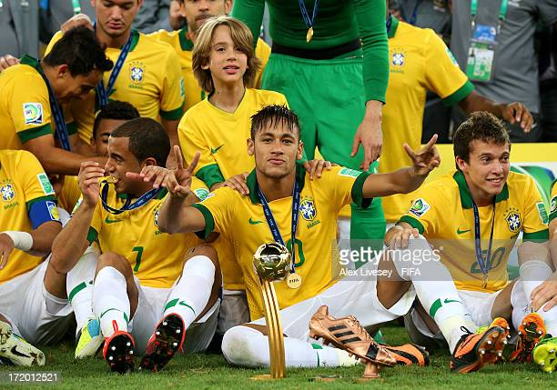 Neymar of Brazil celebrates with his adidas Golden Ball and Bronze boot awards at the end of the FIFA Confederations Cup Brazil 2013 Final match...