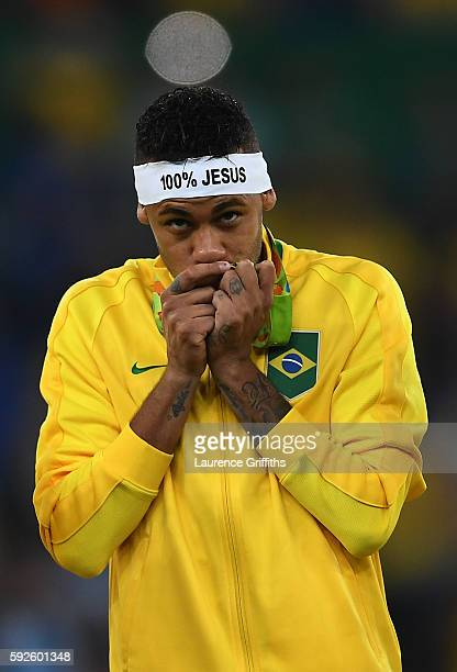 Neymar of Brazil celebrates with his gold medal after the Men's Football Final between Brazil and Germany at the Maracana Stadium on Day 15 of the...