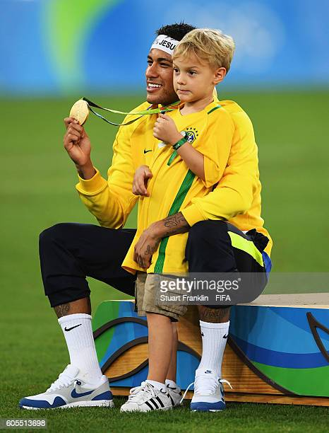 Neymar of Brazil celebrates with his son at the Olympic Men's Final Football match between Brazil and Germany at Maracana Stadium on August 20, 2016...