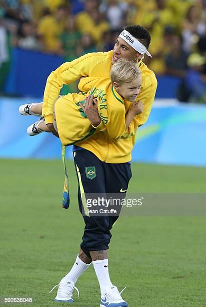 Neymar of Brazil celebrates with his son Davi Lucca da Silva Santos winning the gold medal following the Men's Soccer Final between Brazil and...