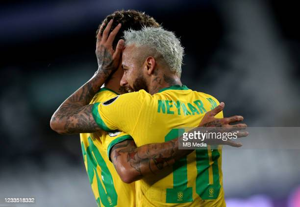 Neymar of Brazil celebrates with his team mate Roberto Firmino during the match between Brazil and Peru as part of Conmebol Copa America Brazil 2021...