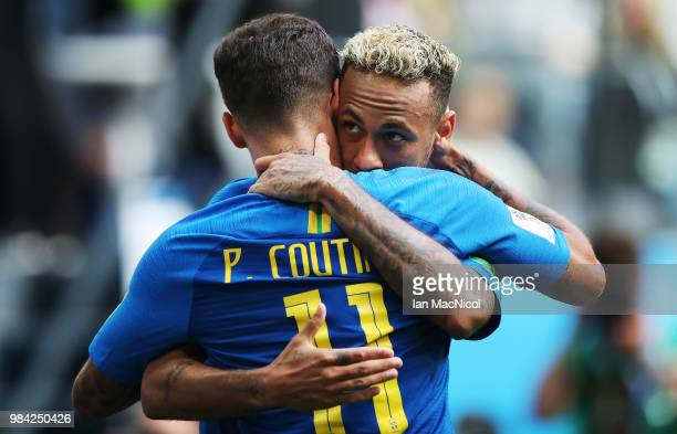 Neymar of Brazil celebrates with Philippe Coutinho after he scores his team's second goal during the 2018 FIFA World Cup Russia group E match between...