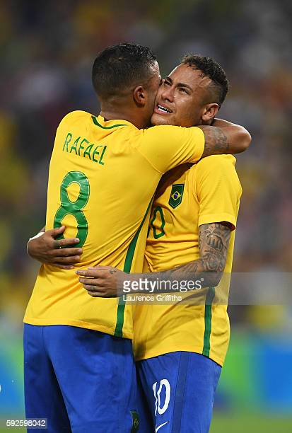 Neymar of Brazil celebrates with team mate Rafinha of Brazil after scoring the winning penalty in the penalty shoot out during the Men's Football...