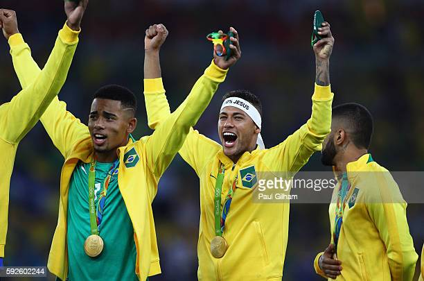 Neymar of Brazil celebrates with team mates after the Men's Football Final between Brazil and Germany at the Maracana Stadium on Day 15 of the Rio...