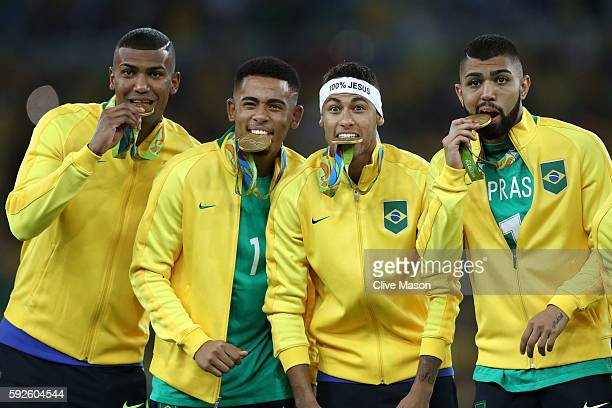 Neymar of Brazil celebrates with team mates following the Men's Football Final between Brazil and Germany at the Maracana Stadium on Day 15 of the...