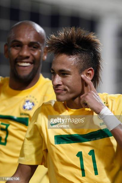 Neymar of Brazil celebrates with teammate Maicon a scored goal against Ecuador as part a match of Group B of Copa America 2011 at the Mario Kempes...