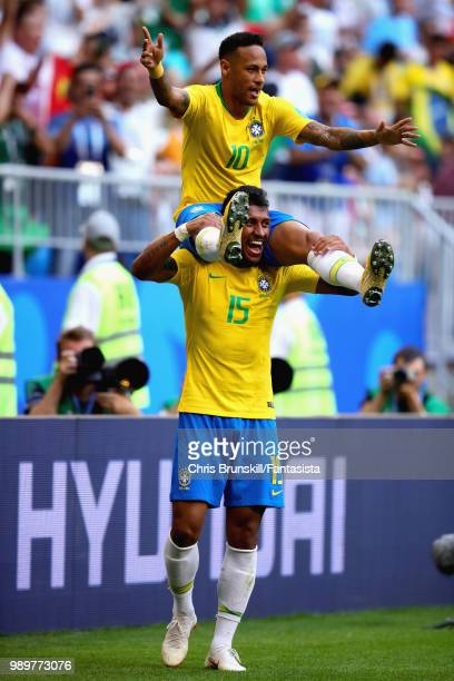 Neymar of Brazil celebrates with teammate Paulinho after scoring his sides first goal during the 2018 FIFA World Cup Russia Round of 16 match between...