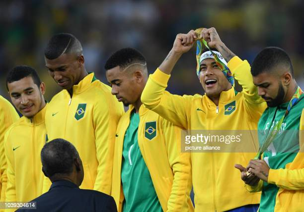 Neymar of Brazil celebrates with teammates during the award ceremony after winning the Men's soccer Gold Medal Match between Brazil and Germany...