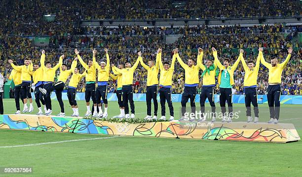 Neymar of Brazil celebrates with teammates winning the gold medal following the Men's Soccer Final between Brazil and Germany on day 15 of the Rio...