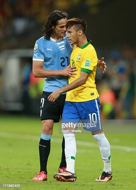 Neymar of Brazil clashes with Edinson Cavani of Uruguay during the FIFA Confederations Cup Brazil 2013 Semi Final match between Brazil and Uruguay at...