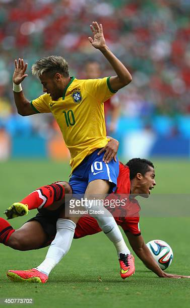 Neymar of Brazil collides with Giovani dos Santos of Mexico during the 2014 FIFA World Cup Brazil Group A match between Brazil and Mexico at Castelao...