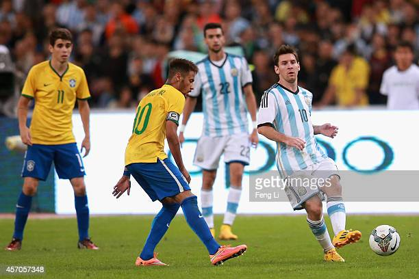 Neymar of Brazil competes the ball with Lionel Messi of Argentina during Super Clasico de las Americas between Argentina and Brazil at Beijing...