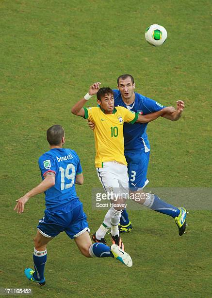 Neymar of Brazil competes with Leonardo Bonucci of Italy and Giorgio Chiellini during the FIFA Confederations Cup Brazil 2013 Group A match between...