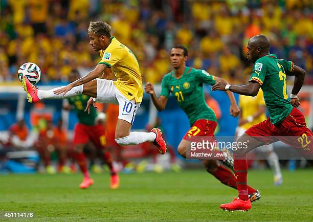 Neymar of Brazil controls the ball against Allan Nyom of Cameroon during the 2014 FIFA World Cup Brazil Group A match between Cameroon and Brazil at...