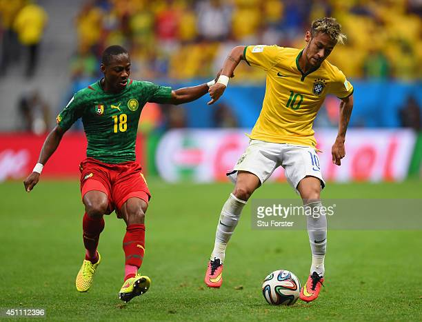 Neymar of Brazil controls the ball against Enoh Eyong of Cameroon during the 2014 FIFA World Cup Brazil Group A match between Cameroon and Brazil at...