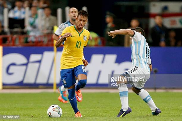 Neymar of Brazil drives the ball during a match between Argentina and Brazil as part of 2014 Super Clasico at Beijing National Stadium on October 11...