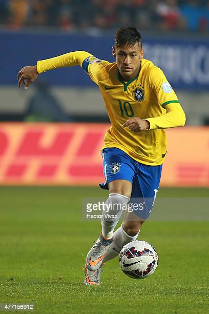 Neymar of Brazil drives the ball during the 2015 Copa America Chile Group C match between Brazil and Peru at Municipal Bicentenario Germán Becker...