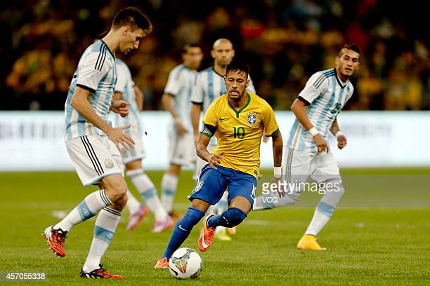 Neymar of Brazil eyes the ball during a match between Argentina and Brazil as part of 2014 Super Clasico at Beijing National Stadium on October 11...