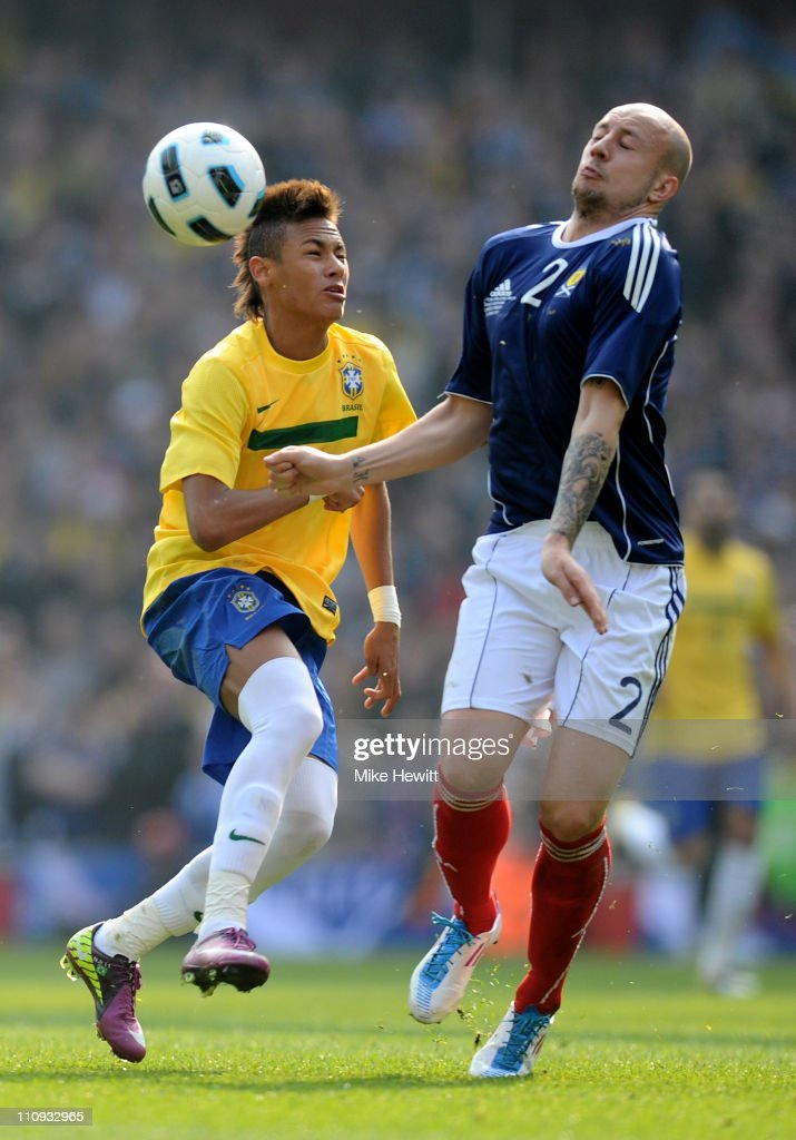 Neymar of Brazil fights for ball with Alan Hutton of Scotland during the International friendly match between Brazil and Scotland at Emirates Stadium on March 27, 2011 in London, England.