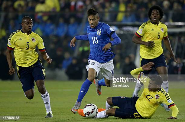 Neymar of Brazil fights for the ball with Jeison Murillo of Colombia during the 2015 Copa America Chile Group C match between Brazil and Colombia at...