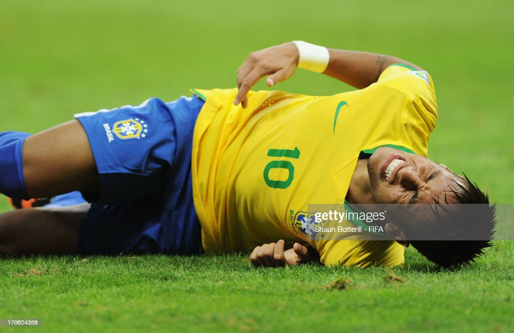 Neymar of Brazil grimaces in pain during the FIFA Confederations Cup Brazil 2013 Group A match between Brazil and Japan at National Stadium on June 15, 2013 in Brasilia, Brazil.