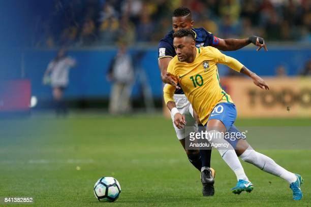 Neymar of Brazil in action against Antonio Valencia of Ecuador during the 2018 FIFA World Cup Russia qualifying match between Brazil and Ecuador at...