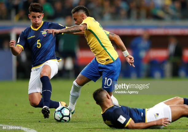Neymar of Brazil in action against Fernando Gaibor of Ecuador during the 2018 FIFA World Cup Russia qualifying match between Brazil and Ecuador at...
