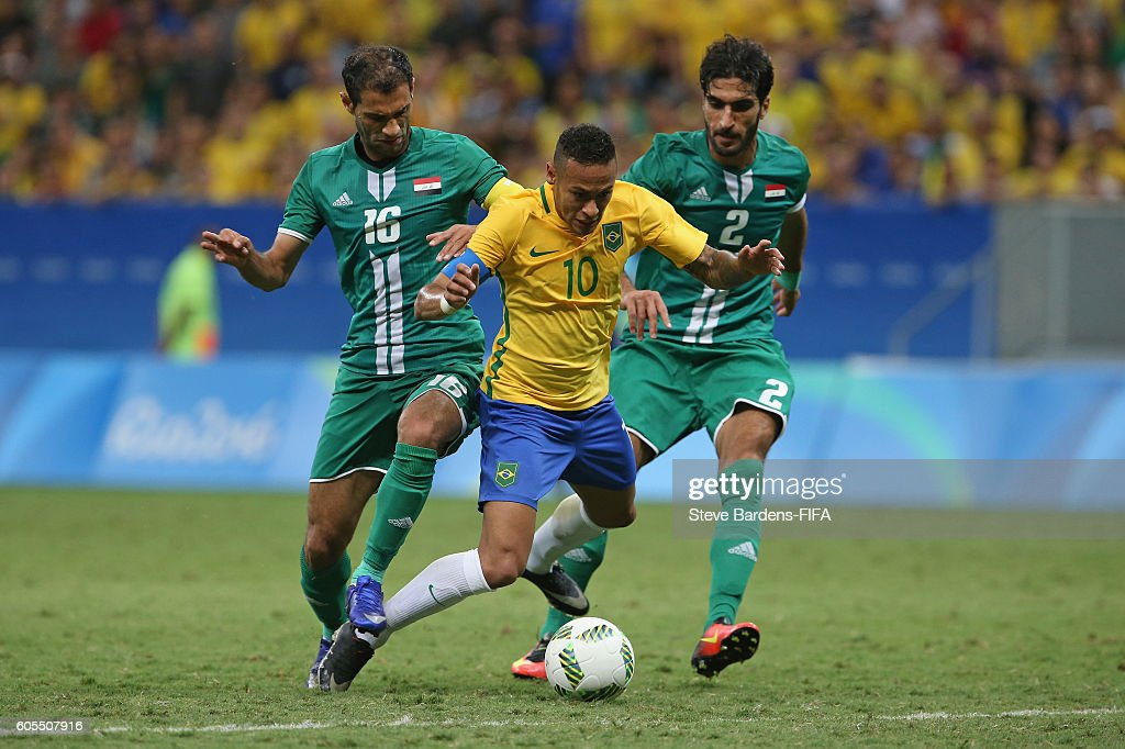 Neymar of Brazil is brought down by Ahmed Ibrahim and Saad