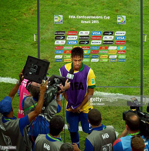 Neymar of Brazil is interviewed following the FIFA Confederations Cup Brazil 2013 Group A match between Brazil and Japan at National Stadium on June...