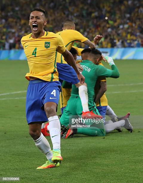Neymar of Brazil is mobbed by team mates as Marquinhos jumps in the air when Brazil win the penalty shoot out during Brazil versus Germany in the...