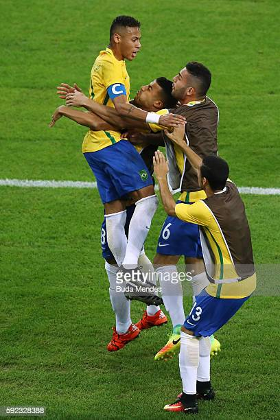 Neymar of Brazil is surrounded by team mates as he celebrates scoring the first Brazil goal during the Men's Football Final between Brazil and...