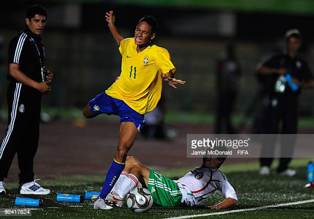 Neymar of Brazil is tackled by Erick Vera of Mexico during the FIFA U17 World Cup match between Brazil and Mexico at the Teslim Balogun Stadium on...