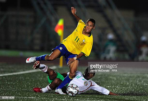 Neymar of Brazil is tackled by Gil Cordero of Mexico during the FIFA U17 World Cup match between Brazil and Mexico at the Teslim Balogun Stadium on...