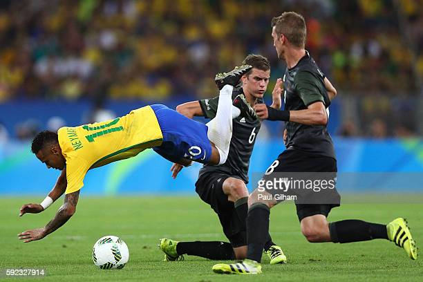 Neymar of Brazil is tackled by Sven Bender of Germany during the Men's Football Final between Brazil and Germany at the Maracana Stadium on Day 15 of...