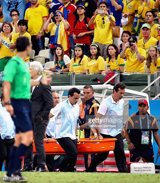 Neymar of Brazil is taken off b a stretcher during the 2014 FIFA World Cup Brazil Quarter Final match between Brazil and Colombia at Castelao on July...