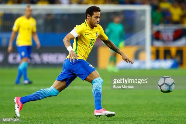 Neymar of Brazil kicks the ball during a match between Brazil and Paraguay as part of 2018 FIFA World Cup Russia Qualifier at Arena Corinthians on...