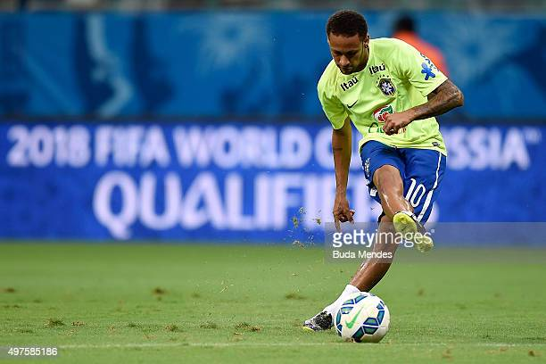 Neymar of Brazil kics the ball during warm up a match between Brazil and Peru as part of 2018 FIFA World Cup Russia Qualifiers at Arena Fonte Nova on...